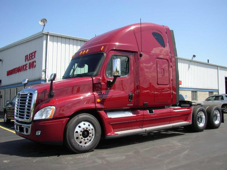 Left Side Red 2010 Freightliner Cascadia Truck Picture