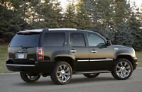 Rear Right Black GMC Yukon Denali Hybrid SUV Picture
