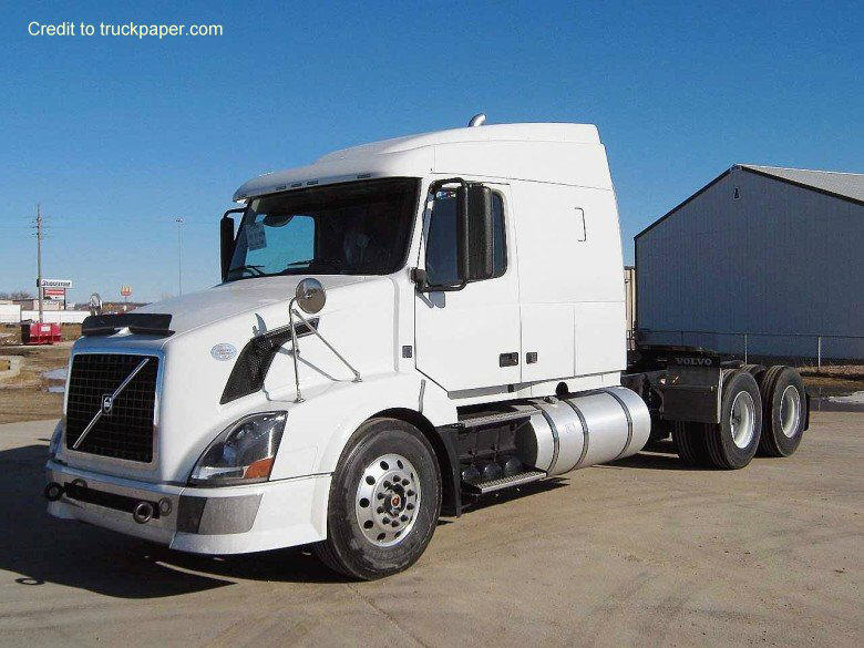 Front Left 2010 Volvo VNL64T630 Truck Picture
