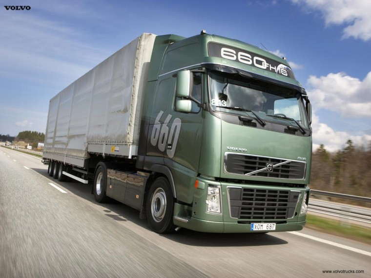 Front right green and gray 2008 volvo fh16 660 truck picture
