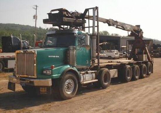 Front left green 2000 Western Star 4964SX truck picture.